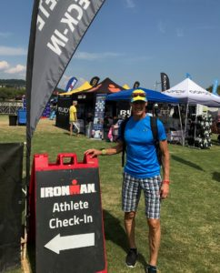 Photo of Don standing next to the Ironman Chattanooga check in sign