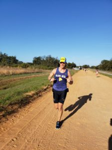 photos of triathletes running on the famous clay trail in Clermont Florida